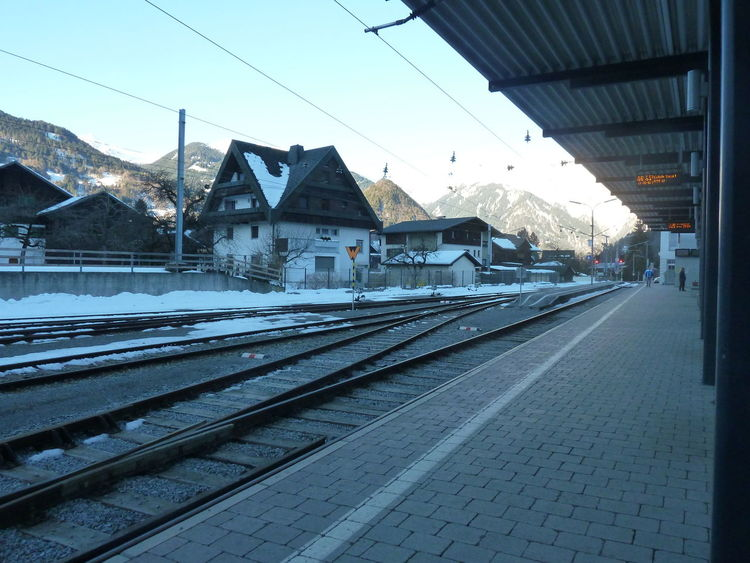 Alps Architecture Building Exterior Built Structure Clear Sky Day Empty Journey Mode Of Transport Power Line  Public Transport Public Transportation Rail Transportation Railway Station Railway Station Platform Railway Track Sky The Way Forward Transportation Travel