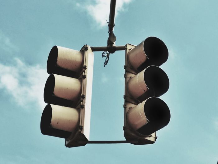 Low Angle View Of Stoplight Against Blue Sky