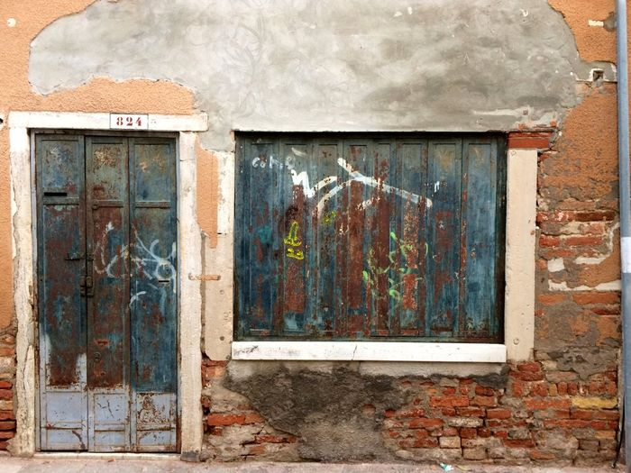 Masks of Venice: where Tourists are Rare beauty is Hidden Architecture Burano, Italy Doors Masks The Week On EyeEm Venice, Italy Weathered Architecture Building Exterior Built Structure Doors And Windows Doors And Windows Around The World Doors With Stories Doorsworldwide Doorway Peeling Off Peeling Paint Run-down Structures & Lines Walls Weathered Walls Window Windows Windows And Doors Windows_aroundtheworld