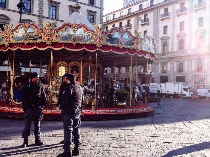 City patrolling forces near a children game. Florence Italy Military Forces Patrol Children Game Outdoor Amusement City Danger Alert War Isis Terrorism Florence Italy