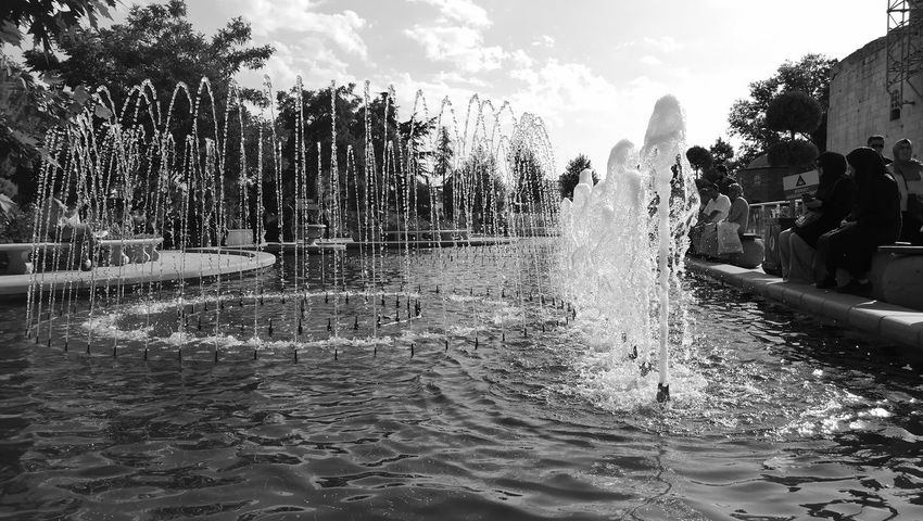 Water Slide Adult Freshness Nature People Tree Wet Fun Day Sky Outdoors Water Spraying Vacations Monochrome Monochrome Photography