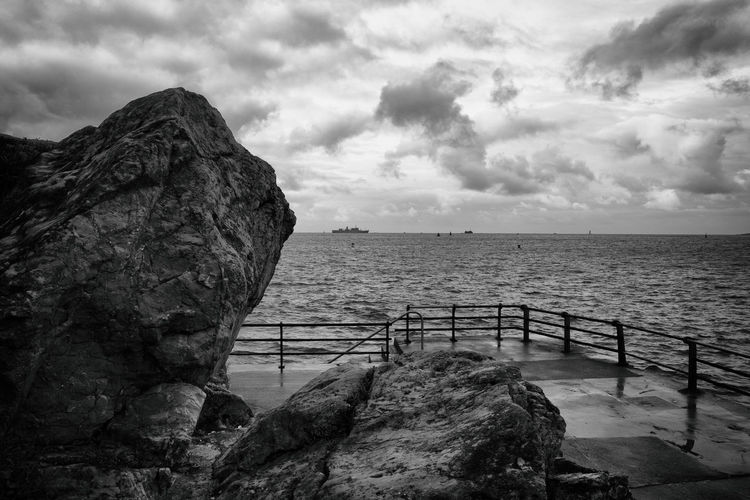 A view from Plymouth Hoe Ocean View Plymouth Beauty In Nature Cliff Clouds Clouds And Sky Day Horizon Over Water Mountain Nature No People Ocean Ocean Photography Outdoors Plymouth Hoe Railing Rock - Object Rock Formation Scenics Sea Sky Tranquil Scene Tranquility Water