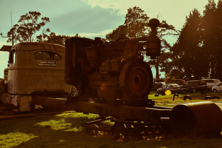 Old rusty generator Be. Ready. Costa Rica Costa Rica 🇨🇷 Costa Rica❤ EyeEm EyeEm Best Shots Building Exterior Built Structure Day Grass History No People Old Maschins, Outdoors Rusty Car Rusty Metal Sky Tree Step It Up