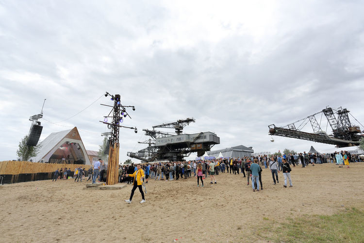 Gremmin Beach at Melt! Festival in Ferropolis, Germany. Built Structure City Life Cloud Cloud - Sky Cloudy Day Excavation Ferropolis Festival Season Festivals Gremmin Beach Group Of People Industrial Landscapes Industriekultur Large Group Of People Leisure Activity Lifestyles Medium Group Of People MELT! Mixed Age Range Nature Outdoors Sky Travel Destinations