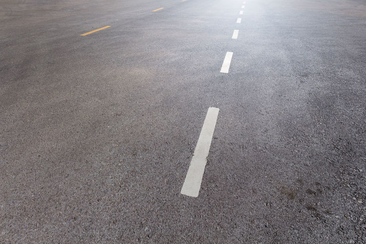 Arrow Symbol Asphalt City Communication Day Direction Dividing Line Empty Guidance High Angle View Marking No People Outdoors Road Road Marking Sign Street Symbol The Way Forward Transportation White Color
