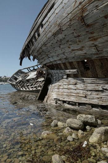 Shipwrecks on shore at camaret-sur-mer against sky