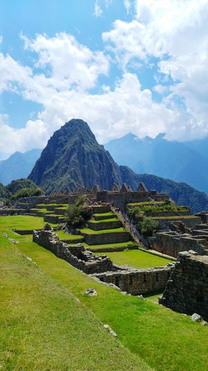 The beautiful Machu Picchu EyeEm Selects Mountain Cloud - Sky Agriculture Outdoors Ancient Landscape Travel Destinations No People Scenics Mountain Range Day Pyramid Nature Ancient Civilization Beauty In Nature Sky Terraced Field First Eyeem Photo Peru Machu Picchu Viewpoint