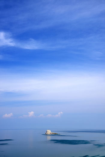 Distant view of olkhon island against blue sky
