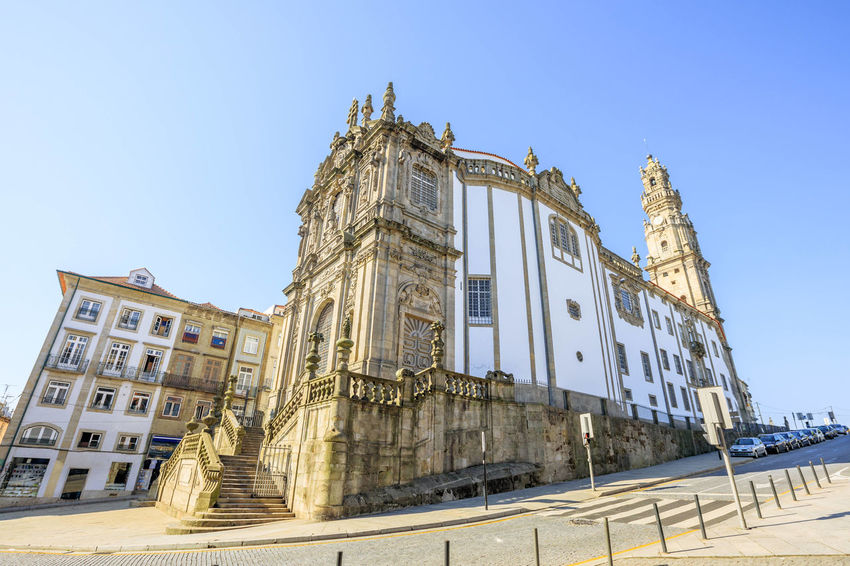 Side view of majestic baroque Church of Clerigos or Igreja dos Clerigos, in Portuguese, and iconic Clerigos Tower, one of the landmarks and symbols of Oporto city in Portugal. Sunny day with blue sky. Portugal Porto Tourism City Aerial View Cloudscape Cityscape Landscape Panorama Europe People Church Church Architecture Architecture Town Porto Portugal 🇵🇹 Monment Oporto City Oporto Downtown Oporto Streets Sky Building Exterior Built Structure Clear Sky Nature History The Past Day Low Angle View No People Blue Building Window Old Sunlight Travel Destinations Outdoors Copy Space