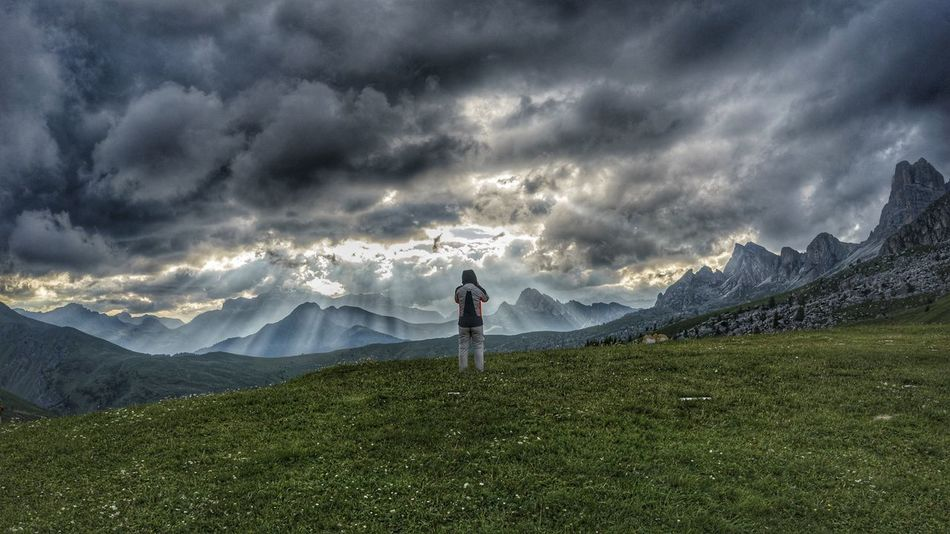 Mountain Dramatic Sky One Person Colle Santa Lucia Travel Destinations San Vito Di Cadore Alps Sky Italy Mountain Range Clouds Landscape Dolomites Valley Passo Giau Panoramic Outdoors People Grass Men Storm Cloud Nature Standing Adult Nature Lost In The Landscape