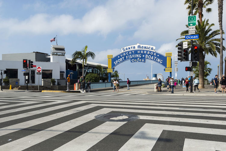 Entrance to Santa Monica Pier, California, United States Travel Monica Santa Pier Sign Park Attraction Amusement  Beach People Coast USA Vacation Los America Tourist Southern Western Vintage Outdoors Sea Building Tourism Street Architecture Traditional Store Famous Landmark Boardwalks Highway Sign Route 66 La Wooden Floor California South California United States Ocean Pacific City Blue Sky Summer Venice Beach Palm Trees Colorful Color Beachfront Destinations Attractions