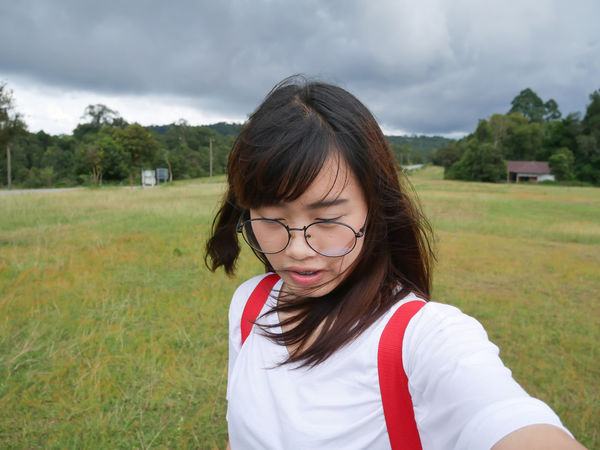 One Person Front View People Grass Focus On Foreground Portrait Day Cloud - Sky Child Outdoors Headshot Only Women Adult Girls One Woman Only Soccer Field Close-up Nature Young Adult EyeEm Best Shots EyeEmNewHere Kaoyai Selfie ✌ Asian Girl Real People