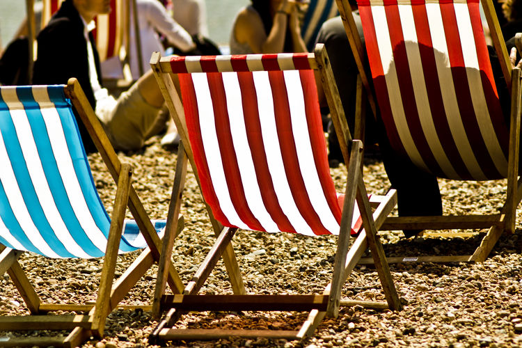 Old one from a trip to Brighton early days of my camera back then Beach Chair Day Deck Chair Deckchairs Holiday Hot Lieblingsteil Low Section No People Outdoors Relax Striped Sunbathing Sunchair Miles Away The City Light The Street Photographer - 2017 EyeEm Awards Live For The Story