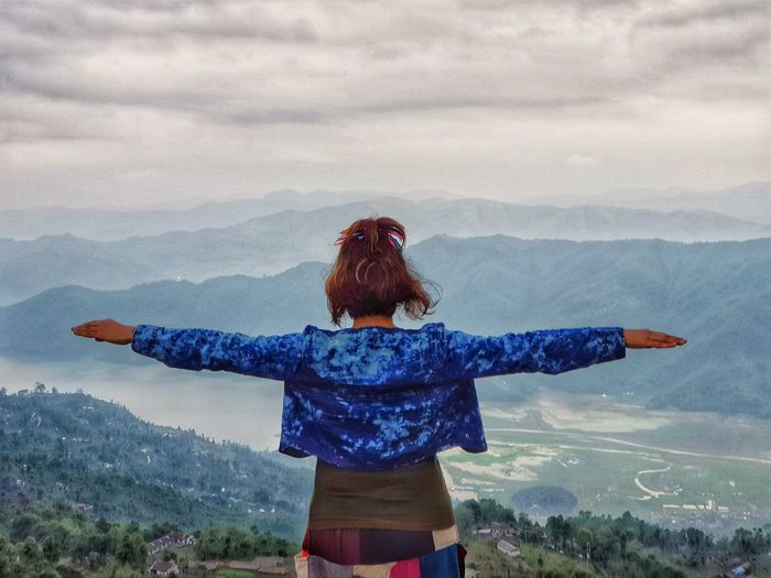 I am on the top of The World... Travel Destinations Travel Travel Photography EyeEm Best Shots EyeEm Nature Lover Nature_collection Cloud - Sky EyeEmBestPics EyeEm Selects Pokhara Nepal Warm Clothing Young Women Women Mountain Human Hand Youth Culture Standing Winter Snow Happiness Snowfall Hiker Arms Outstretched Ski Jacket Snowcapped Mountain
