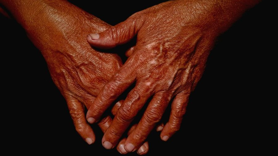 Close-Up Of Old Wrinkled Hands