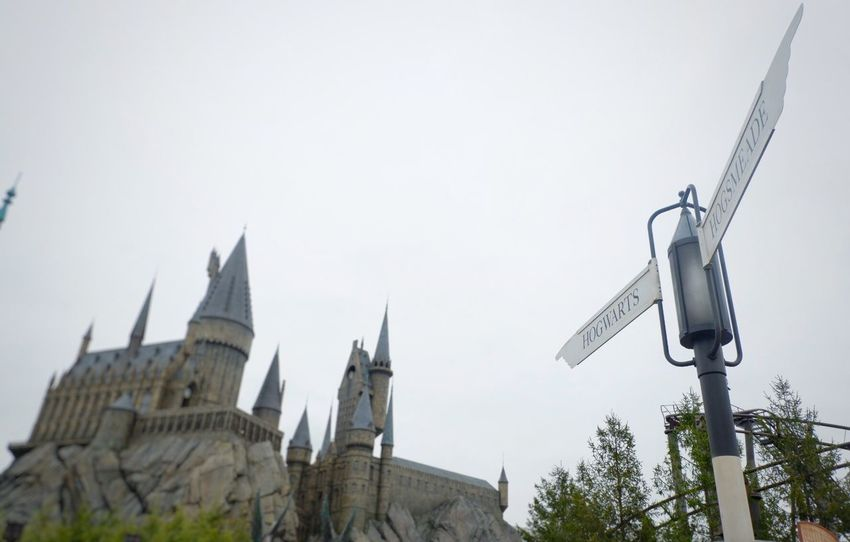Guidepost with Hogwarts castle in the background at Universal studio ,Osaka Japan Witch Amusement Park Sky Close-up Ravel Magic Castle Japan OSAKA Universal Studios  Hogwarts Blur Harry Potter Harrypotter Guidepost Sign Low Angle View Architecture Clear Sky No People Built Structure Building Exterior Outdoors Day Sky