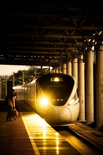 夕阳落下林后,晚风吹过站台,我的那趟列车,正在缓缓开来。 station Transportation Rail Transportation Train Light Passenger Evening Sunset Railway Station