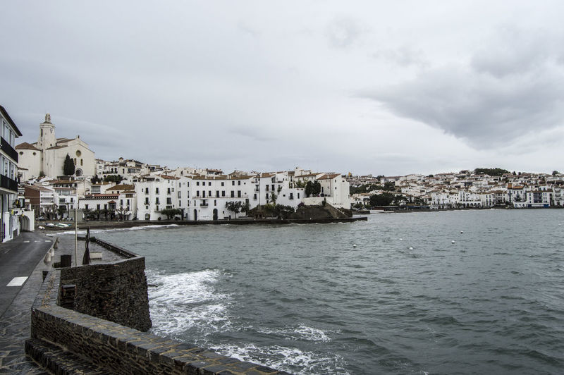Cadaques Architecture Building Exterior Built Structure Cadaqués Canal City Cityscape Cloud Cloud - Sky Cloudy Costa Brava Day Mediterranean  Nature No People Outdoors Residential Building Residential District Residential Structure Rippled River Sky Town TOWNSCAPE Water