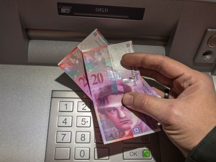 Cash withdrawing at an ATM at dusk - Moneybox Atm Cash Box Security Secure Human Finger Human Hand Money Cash Switzerland Swiss Franc CHF Bank Finance Taking Off Withdraw Money Obtain Receive Economy Currency Keys Numbers Ok Safety Features Copy Protection
