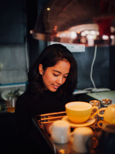 Adult Beautiful Woman Casual Clothing Drink Food And Drink Glass Hair Hairstyle Holding Indoors  Leisure Activity Lifestyles One Person Real People Restaurant Selective Focus Table Waist Up Women Young Adult Young Women
