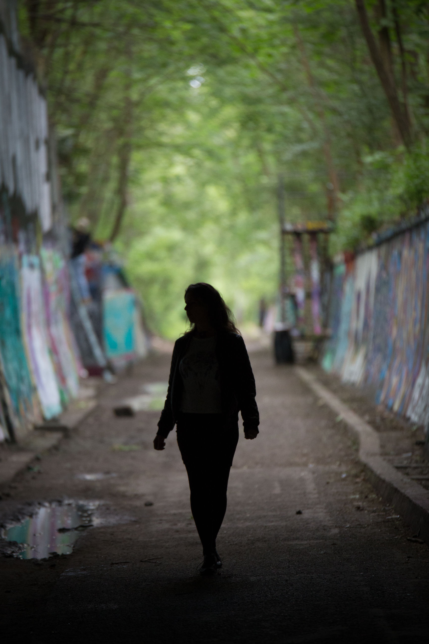 one person, full length, rear view, walking, adult, snapshot, green, architecture, women, city, road, graffiti, solitude, infrastructure, lifestyles, footpath, clothing, standing, outdoors, street, loneliness, nature, tree, young adult, day, alley, spooky, darkness, emotion