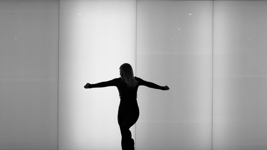 Silhouette Woman Standing Against Wall
