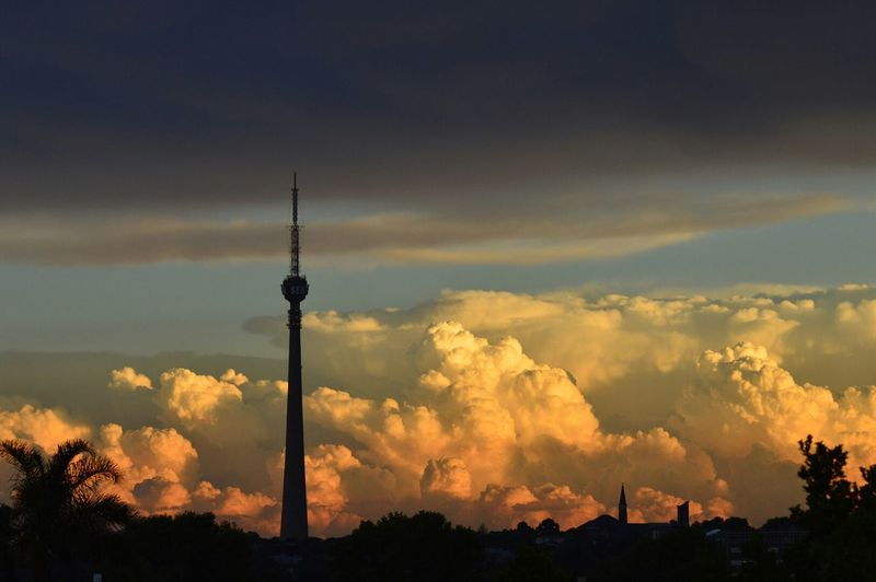 Silhouette Sentech Tower Against Cloudy Sky During Sunset