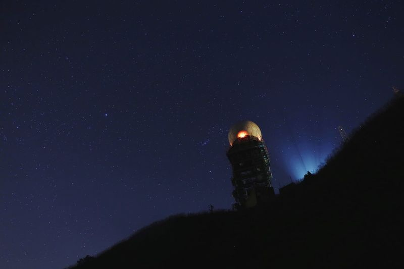 Low Angle View Of Tower On Silhouette Mountain Against Sky At Night