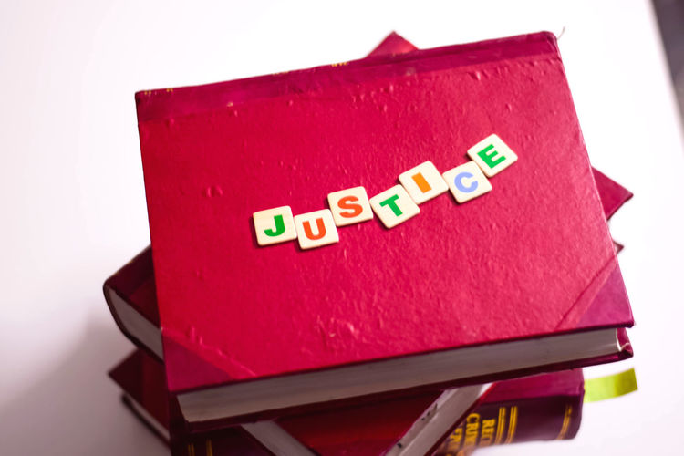 justice written with block letters on red law books Indoors  Red White Background No People Studio Shot Still Life Western Script Text Communication Lawbooks Law And Order  Law And Justice Law Lawyers Justice Justice - Concept Justice League Judgement Judgement Day Judgemental Judge - Law Judging Judgements