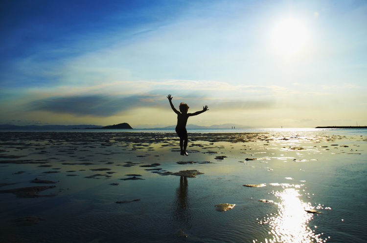 Happy Arms Outstretched Arms Raised Beach Energetic Horizon Over Water Jumpforjoy Kid Nature One Person Outdoors Sea Silhouette Sky Sunset Water