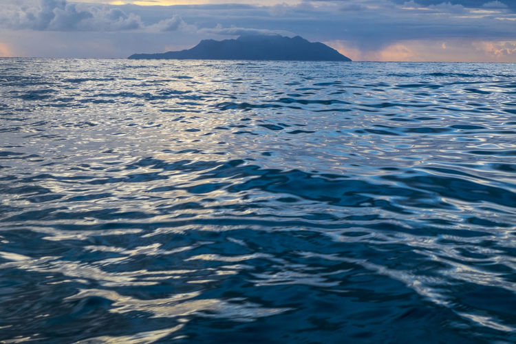 WAVES OF THE SEA Beauty In Nature Cloud - Sky Day Horizon Idyllic Marine Mountain Nature No People Non-urban Scene Outdoors Remote Rippled Scenics - Nature Sea Sky Tranquil Scene Tranquility Water Waterfront