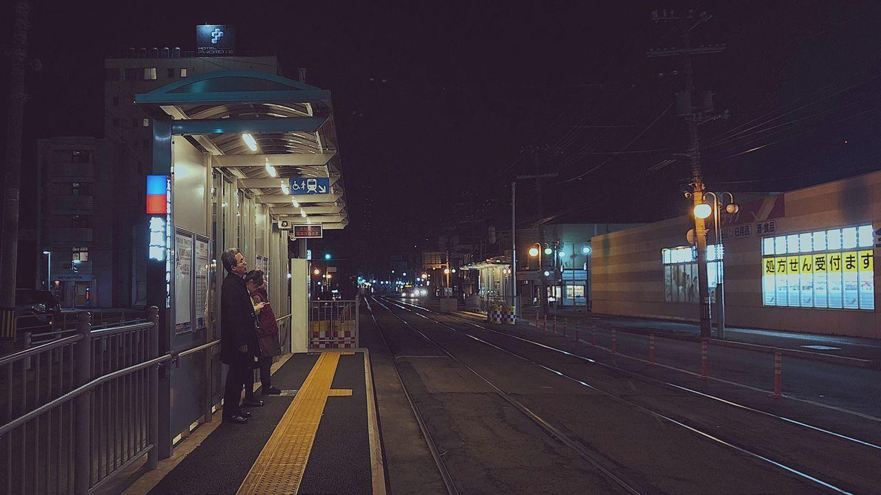 ILLUMINATED RAILROAD TRACKS AT NIGHT