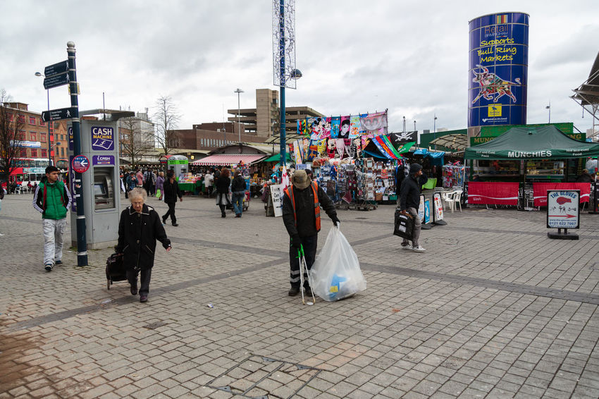 Street cleaning in Birmingham city centre in UK, with sparse crowd outside the Bull Ring open air market. Adults Only Architecture City City Center Cloud - Sky Cobbelstone Street Day High Visibility Jackets In Background Open Space Outdoor Market Outdoors People Sky Street Cleaner Wide Angle