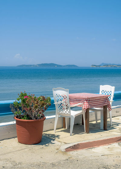 Beach Beauty In Nature Blue Chair Clear Sky Corfu Day Greece Greece Islands Horizon Over Water Mediterranean  Nature No People Outdoors Plant Restaurant Sand Sea Sky Summer Sunlight Table For Two Tranquil Scene Tranquility Water
