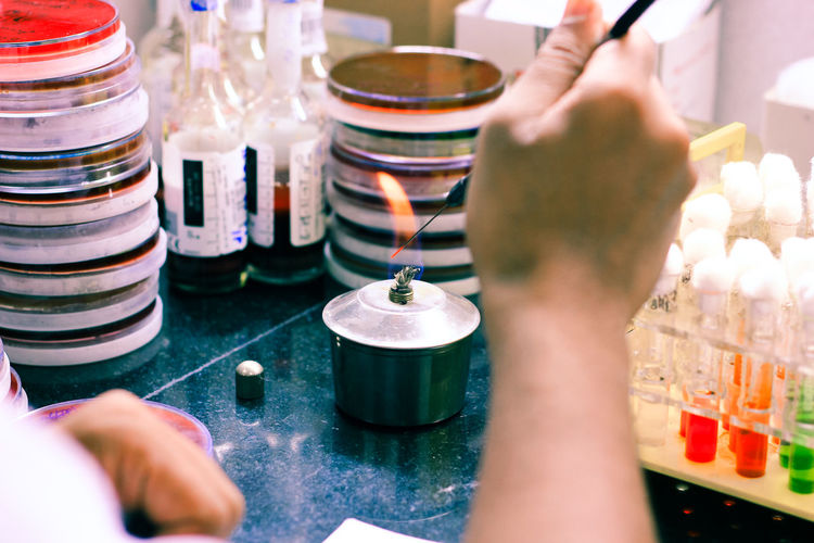 Close-up of person hands experimenting in laboratory