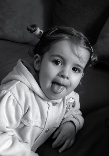 Cheeky Naomi stayed still long enough for this photo. Big Eyes Blackandwhite Photography Cheeky Face Light And Reflection Mission Five Poking Out Tongue Portrait Of A Child Pretty Girl