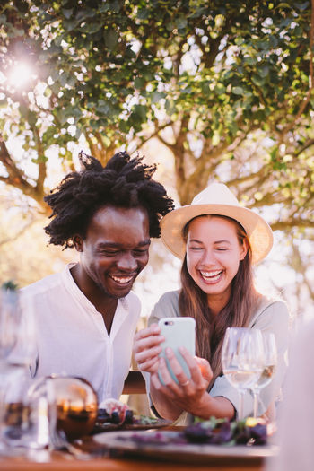 Smiling Happiness Emotion Togetherness Two People Young Adult Real People Lifestyles Bonding Adult Women Portrait Leisure Activity Young Women Friendship Glass Holding Food And Drink Young Men Drink Positive Emotion Couple - Relationship Outdoors Technology Phone