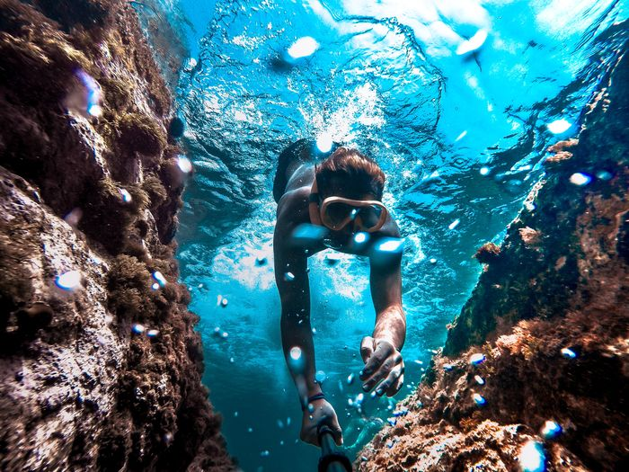 Low Angle View Of Man Snorkeling Undersea