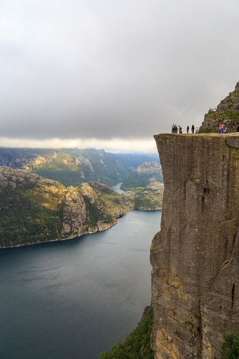 Low angle view of people walking on mountain