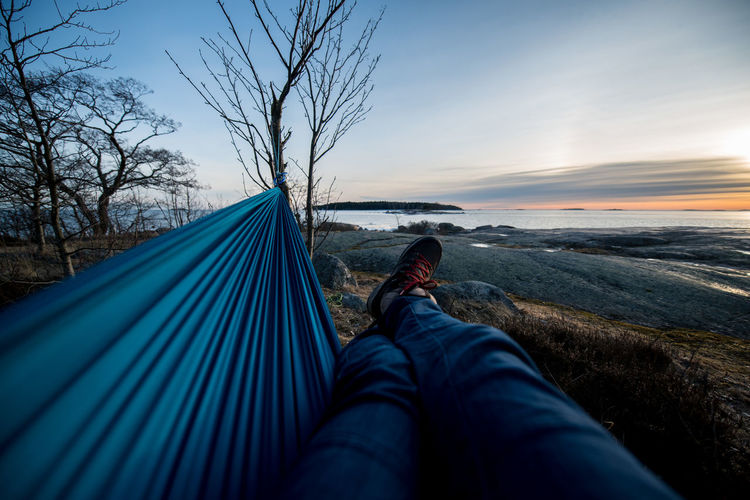 Adult Adults Only Baltic Sea Bare Tree Beauty In Nature Day Finland Hammock Helsinki Low Section Lying Down Men Nature One Man Only One Person Outdoors People Sea Sky Sunset Tree Vacations Water Winter Young Adult