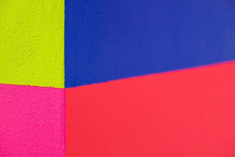 Abstract geometric pattern on concrete wall Backgrounds Blue Choice Close-up Copy Space Creativity Full Frame High Angle View Indoors  Multi Colored No People Orange Color Pattern Pink Color Red Shape Textured  Variation Wall - Building Feature Yellow