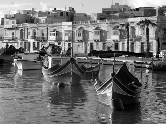 Marsaxlokk, Malta Bnw_harbor Bnw_friday_eyeemchallenge Water Nautical Vessel Transportation Architecture Reflection Maltese Boats Harbor Building Exterior Built Structure Building Traditional Boats