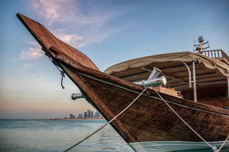 The Dhow Qatari traditional boat Sky Water Nature Nautical Vessel Transportation Day Sea No People Outdoors Travel Sunlight Rope Moored Land Ship Cloud - Sky Fishing Boat Beach Fishing Industry