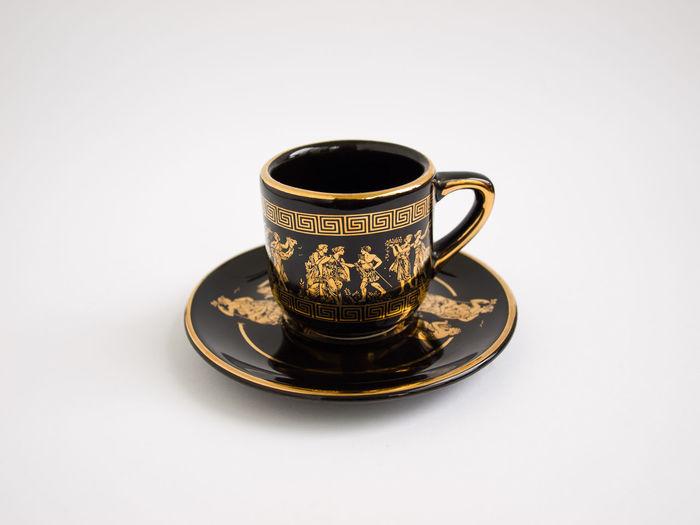 golden tea cup