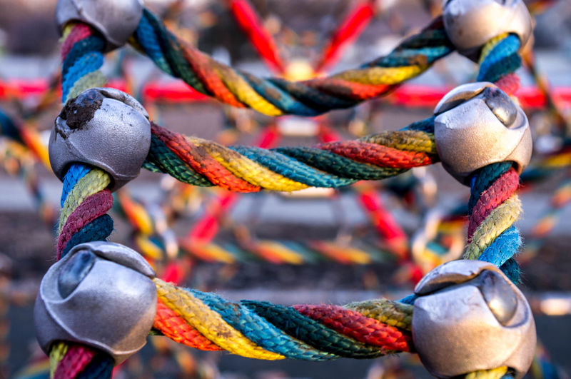 Close-up of colorful rope equipment at playground
