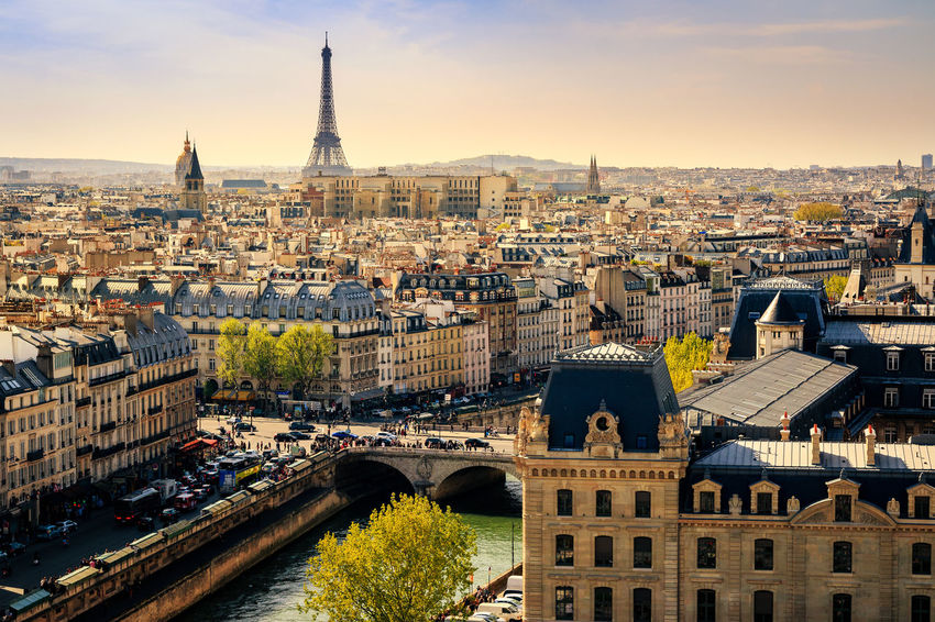 Paris, City of Light - Golden light falls across Paris in early Spring, late afternoon. Shot from the towers of Notre-Dame Cathedral. Architecture Building Exterior Built Structure City Cityscape Day Eiffel Tower Europe Golden High Angle View Light Notre Dame Old Buildings Outdoors Paris River Seine River Sky Skyline Springtime Travel Travel Destinations Urban Water
