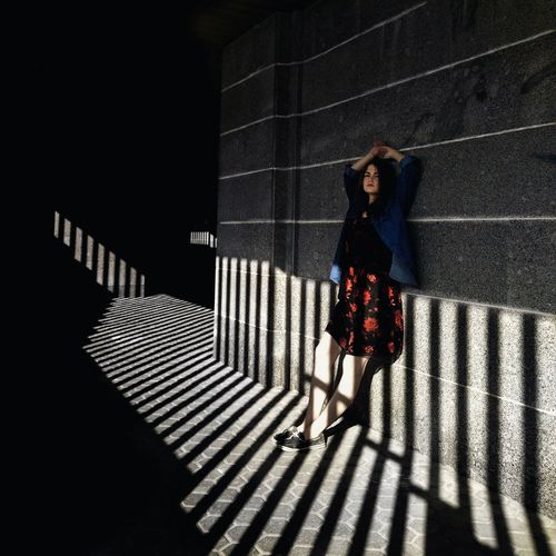Full Length One Person Walking Shadow People Standing One Woman Only Person Indoors  Horizontal Day Adult The City Light