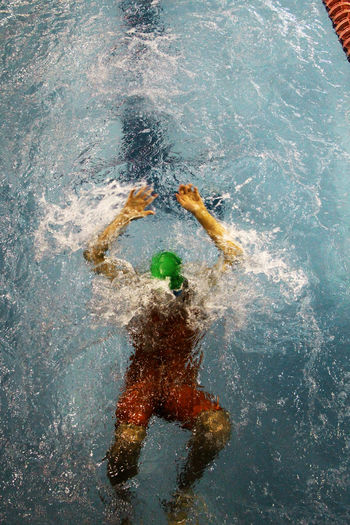 High angle view of athlete swimming in pool