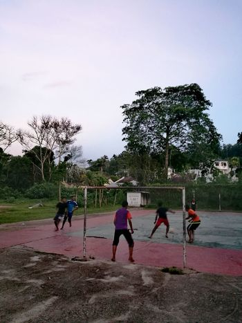 Barefoot soccer, football, rich vs poor. Sport Playground Teamwork Playing
