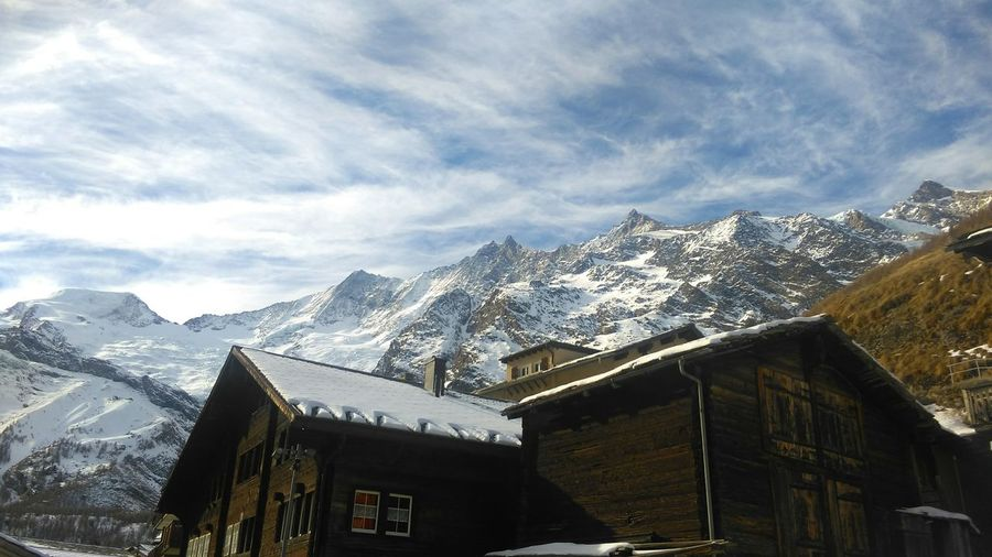 Snow Mountain Cold Temperature Winter Tradition Building Exterior Architecture Landscape Travel Destinations Outdoors Sky No People Nature Travel Travel Photography Swiss Mountains Switzerland Snowy Mountains Saasfee House Day Cloud - Sky